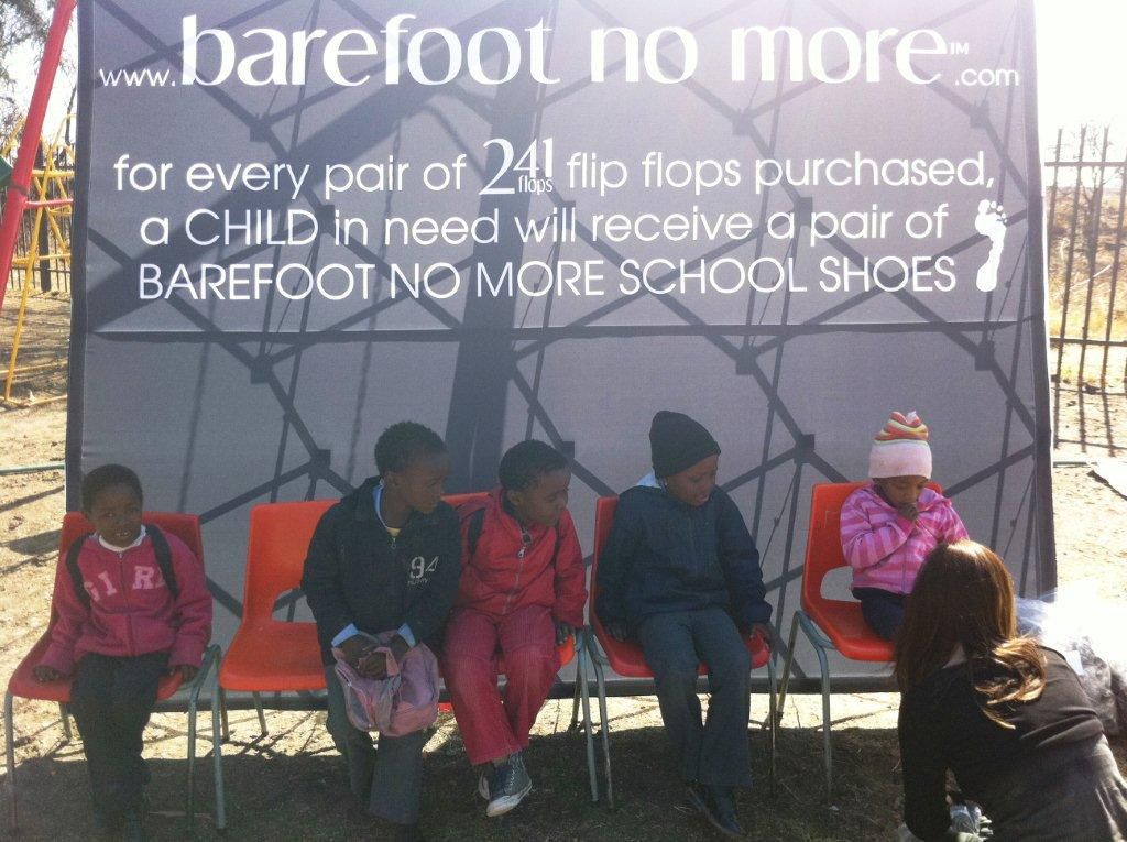 khulusa school 4 - being fitted with school shoes